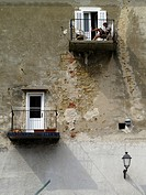 A man sits on a balcony in the coastal town of Piran in southern Slovenia