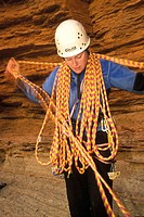 Woman climber laden with rope Grand Canyon National Park Arizona USA