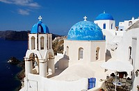 Greece, Santorin island, Oia Ia on the cliff, white house, white church with blue dome, typically Cycladic, Caldeira