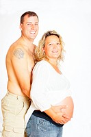 Husband and pregnant wife holding her belly, abdomen