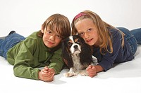 Children with Cavalier King Charles Spaniel, tricolour