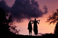 Ethiopia, Lower Omo Valley, listed as World Heritage by UNESCO, members of the Surma Tribe at sunset