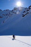 Italy, Valle d´Aosta The Aosta Valley, touring skier climbing to the top of Gran Pays Mountain