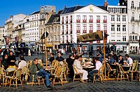 France, Nord, Lille, locals on the terrace of a cafe at the corner of La Place du Général de Gaulle also known as Grand Place