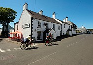 Cushendun village with two touring cyclists