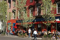 New York City (USA): people eating in the street during springtime in SoHo