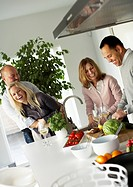 Two couples making dinner together Sweden.