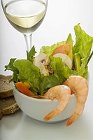 Close_up of prawns and salad served with bread