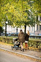 A couple taking a walk with their son Sweden.