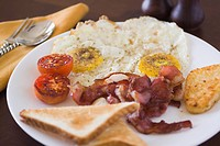 Close_up of fried eggs and bacon on a plate