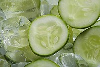 Close_up of cucumber slices on ice cubes