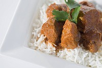 High angle view of mutton curry served with rice
