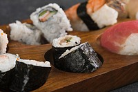 Close_up of various sushi on a cutting board