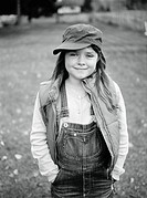 Portrait of a girl with a cap and dungarees Sweden.