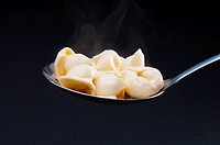 Close_up of tortellini on a spoon