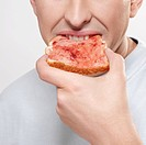 Man eating jam on toast