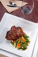 High angle view of steak served with green beans