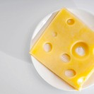 High angle view of a slice of emmenthal cheese
