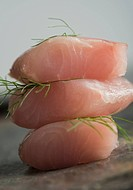 Close_up of slices of fish with herbs