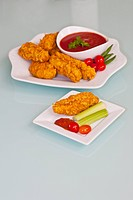 Batter fried chicken with ketchup