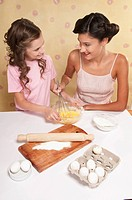 High angle view of mother and daughter baking together