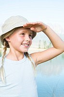 Girl 8_13 blond, looking into the distance, wearing hat, outdoors