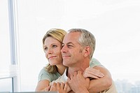 Mature couple hugging and smiling (thumbnail)