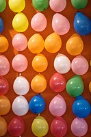 Wall covered in colourful balloons at Oktoberfest, Munich, Germany