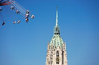 Steeple of St Paul's church with carousel, Oktoberfest, Munich, Germany (thumbnail)