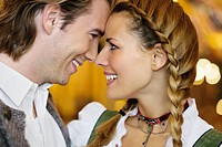 Close_up of young couple flirting at Oktoberfest beer festival, Munich, Germany