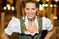 Close_up of young woman in Bavarian outfit at Oktoberfest, Munich, Germany