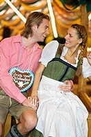 Young couple flirting at Oktoberfest beer festival, Munich, Germany