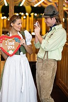 Young woman posing for photo at Oktoberfest, Munich, Germany