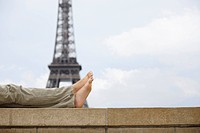 Close up of mans legs with Eiffel tower in background, Paris, France