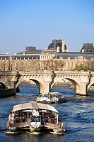 Tourist boat on river Seine with Pont Neuf bridge in background, Paris, France