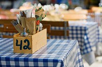 Cutlery in wooden box on typical German beer garden table, Munich, Germany
