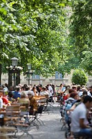 Large group of people in beer garden, Munich, Bavaria, Germany