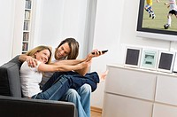 Couple fighting over remote control