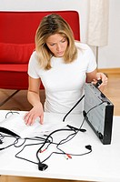Woman trying to connect DVD player