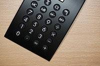 Close up of black calculator from above