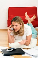 Woman on phone doing home finances