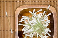 Close up of cotton buds in wooden bowl