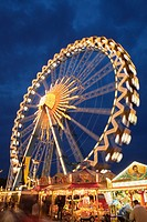 Illuminated Ferris wheel at night, Oktoberfest beer festival, Munich, Germany