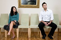 Young couple sitting on chairs