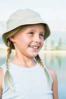 Girl 8_13 blond, looking to the side, wearing hat, outdoors