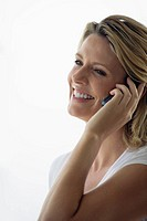 Mature woman smiling while using Cell phone