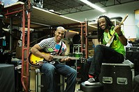 African men with electric guitars in warehouse