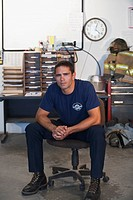 Hispanic fireman sitting in office