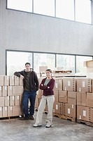 Hispanic man and woman in warehouse