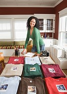 Mixed race woman with t_shirt home business